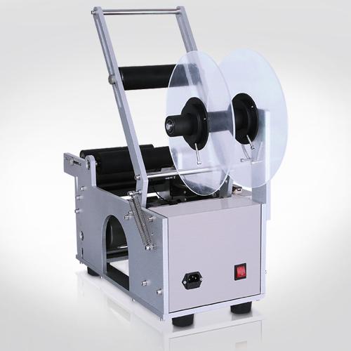 توريد-ماكينه-لصق-لايبل-نصف-آلية-عبوات-دائرية-من-شركة-البكار-التجارية